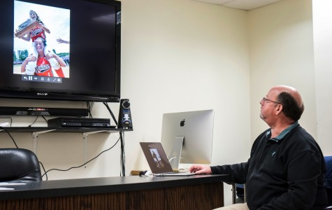 Professional photographer speaks with AIC's photojournalism club
