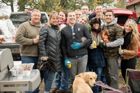 A group of happy tailgaters.