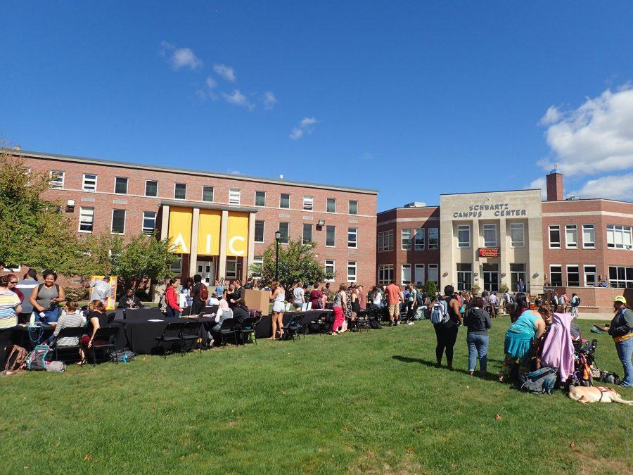An early fall day with fine weather brings students out to the Quadrangle.