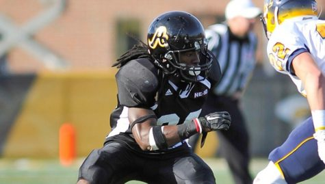 AIC Football Defensive Back Devonte Dillion in action.