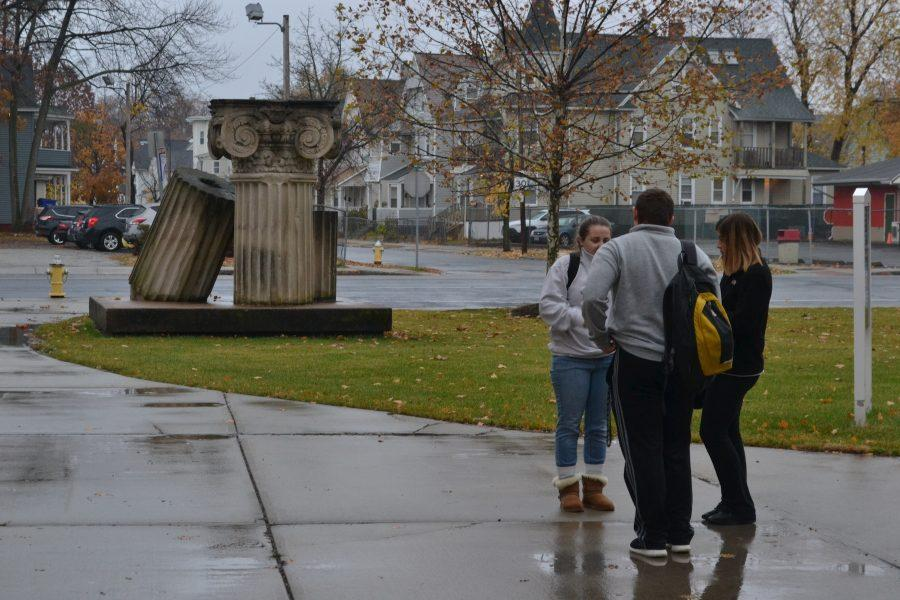 The rain never stops AIC students from sharing friendly comunication after class. AIC's environment encourages lasting friendships despite any weather. (Photo by Ryan LaFrance)