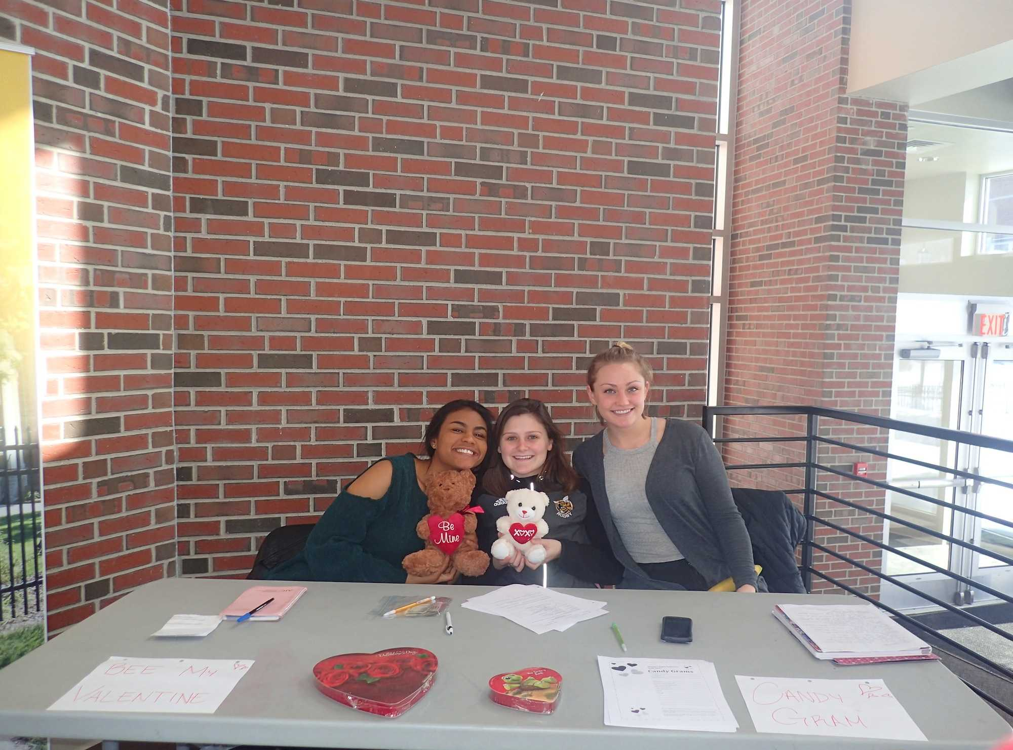 Shanell Russo, Ally Pothier and Molly Plante helping raise money for the women's rugby team.