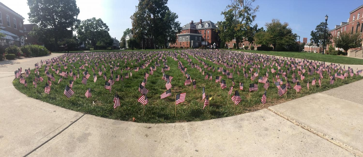 Student+volunteers+placed+2%2C996+flags+on+the+Quad+in+memory+of+the+lives+lost+on+September+11%2C+2001.
