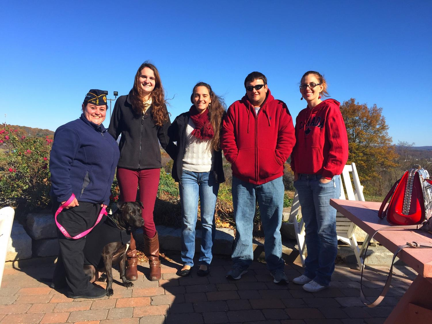 L-R: Alyssa Reardon (U.S. Air Force Veteran & President of the AIC Armed Forces Club) and service dog MJ, Allison Gavin (President of the AIC Lion's Club), Jennifer Fannon (Member of the AIC Lion's Club), Robby Ollari (Editor of the YJ), Janelle Fried (Treasurer of the AIC Lion's Club) at the Soldiers' Home in Holyoke, Mass.