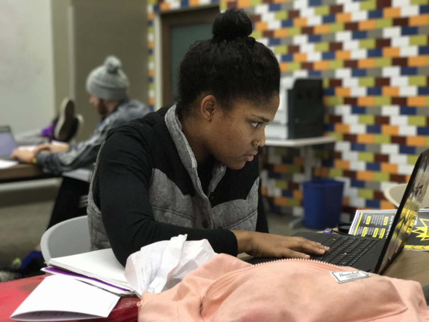 AIC student Lauren Spoon locks in on her studies as the semester winds down.