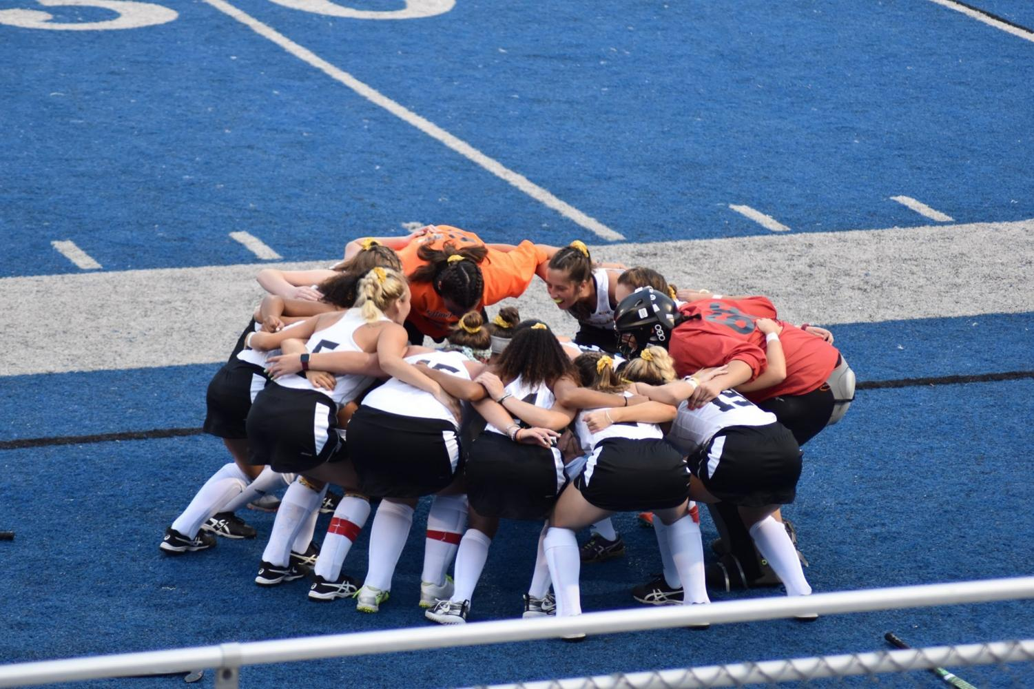 Huddle up: the field hockey girls join together to hype each other up!
