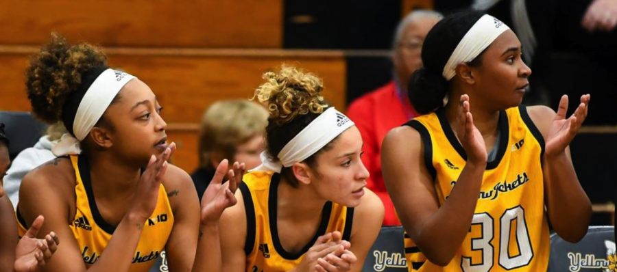 Nyrie Holliman, AJ Washington and Rashana Siders, cheering their teammates during the game captured by RJB Sports