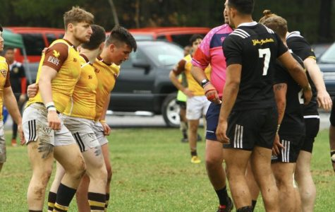 AIC men's rugby approaching St. Bonaventure University.