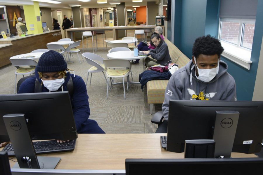 Troy Baxter (Left) and Kyle Jackson (right) wear face masks to protect themselves against Coronavirus