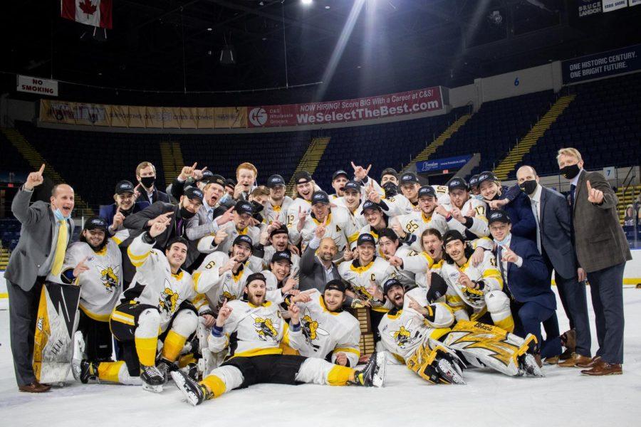 AIC Hockey celebrates after winning the Atlantic Hockey Championship.